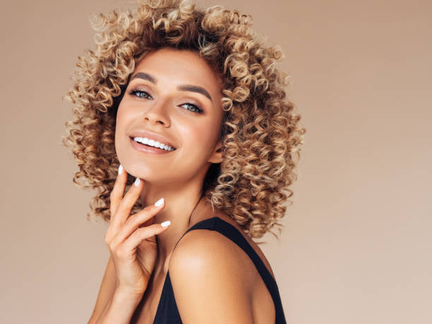 Beautiful young woman with curly hair Beautiful young woman with curly hair curly hair stock pictures, royalty-free photos & images