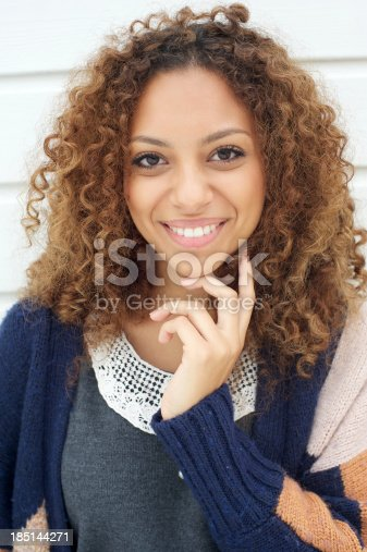 186534921 istock photo Beautiful young woman with curly hair smiling outdoors 185144271