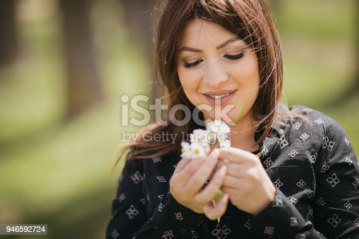 Beautiful young woman with daises