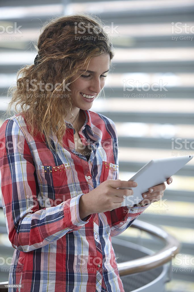 Beautiful young woman with digital tablet royalty-free stock photo