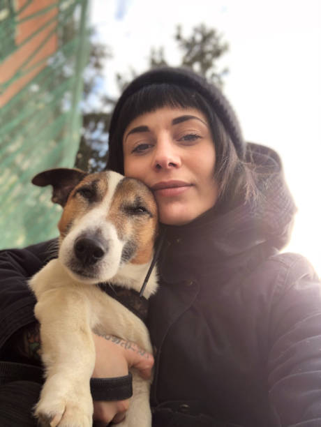 beautiful young woman with dog - selfie foto e immagini stock