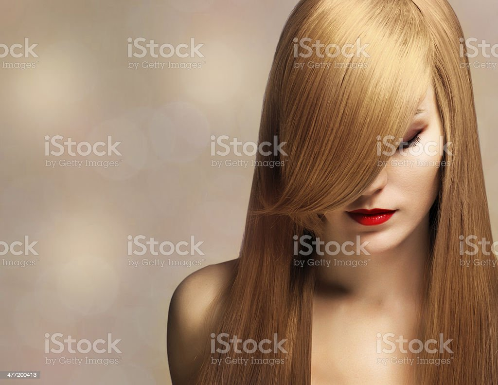 beautiful young woman with elegant long shiny hair stock photo