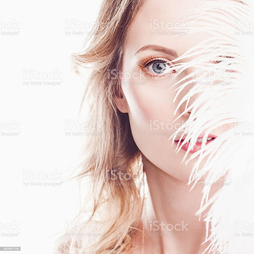 Beautiful young woman with elegant make-up stock photo