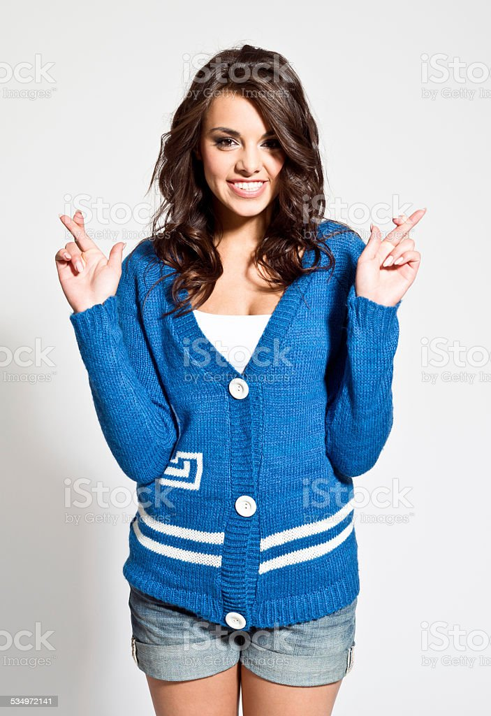 Beautiful young woman with fingers crossed - Royalty-free 20-24 Years Stock Photo