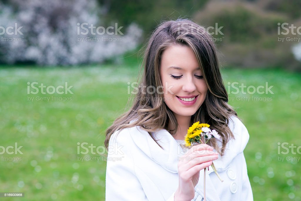 Beautiful young woman with flower, alergy stock photo