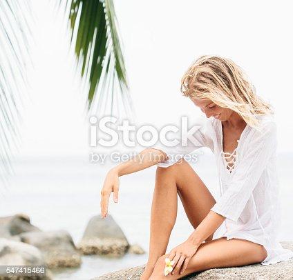 670374358 istock photo Beautiful young woman  with frangipani flower 547415466