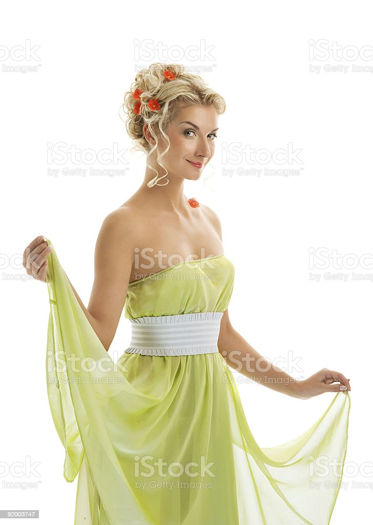 Beautiful young woman with fresh spring flowers in her hair. royalty-free stock photo