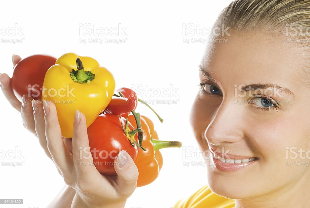 Beautiful young woman with fresh vegetables royalty-free stock photo