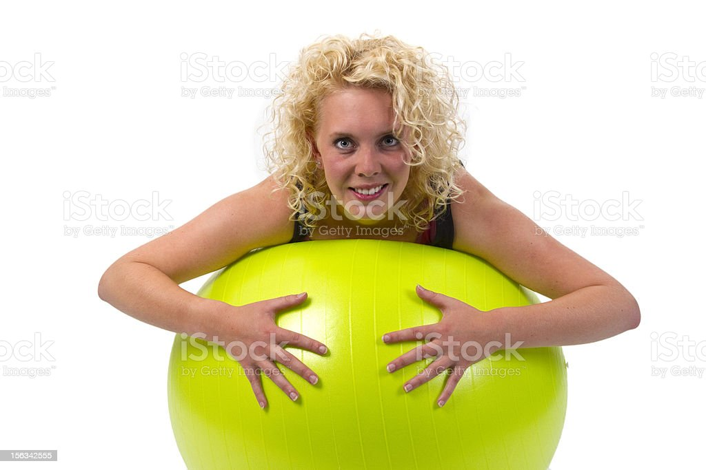 Beautiful young woman with gym ball royalty-free stock photo
