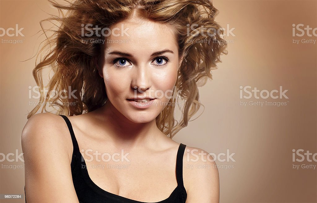 beautiful young woman with hair flying royalty-free stock photo
