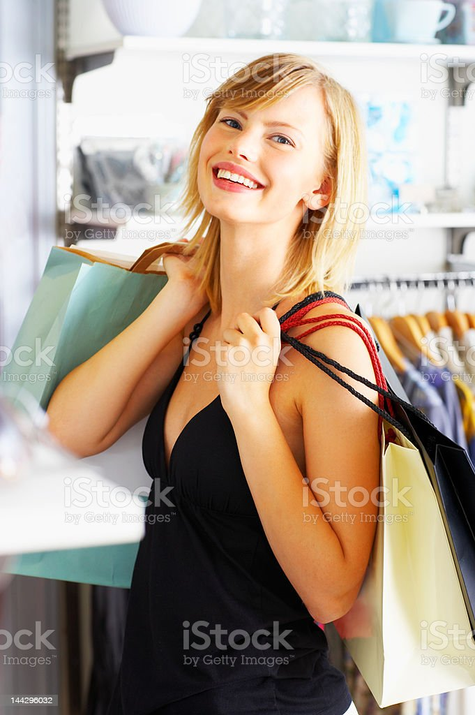 Beautiful young woman with her shopping bags royalty-free stock photo