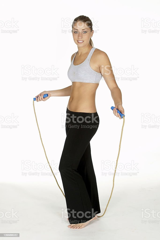 Beautiful Young Woman with Jump Rope royalty-free stock photo