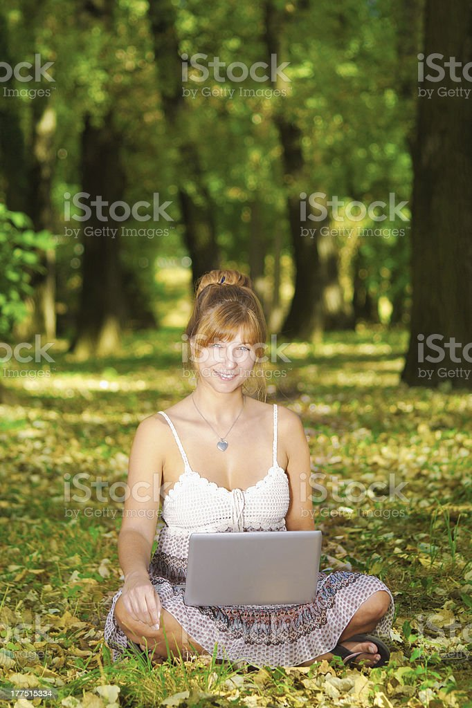 Beautiful young woman with laptop royalty-free stock photo