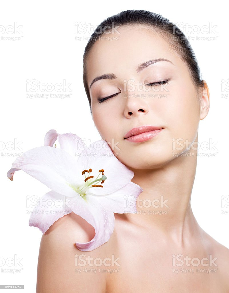 Beautiful young woman with lily royalty-free stock photo