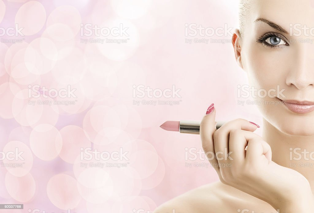 Beautiful young woman with lipstick over abstract pink backgroun stock photo