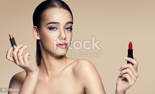 istock Beautiful young woman with lipstick 511792420