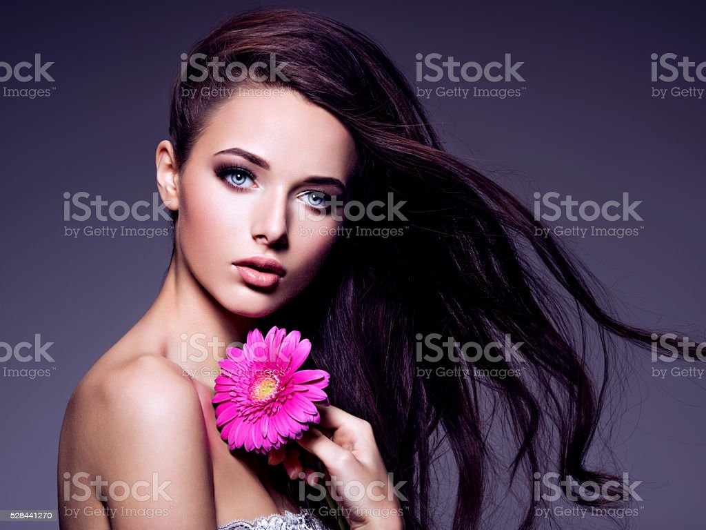 beautiful  young woman with long brown  hair stock photo