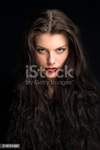 istock beautiful young woman with long brown hair portrait 516254392