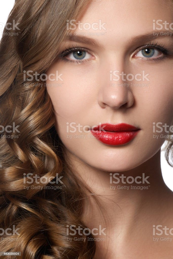 Beautiful young woman with long curly hair. Beautiful model stock photo