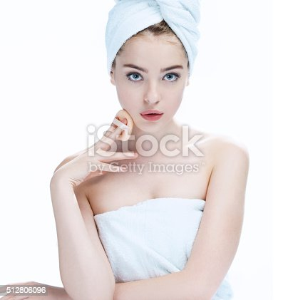 532331272 istock photo Beautiful young woman with make up face 512806096