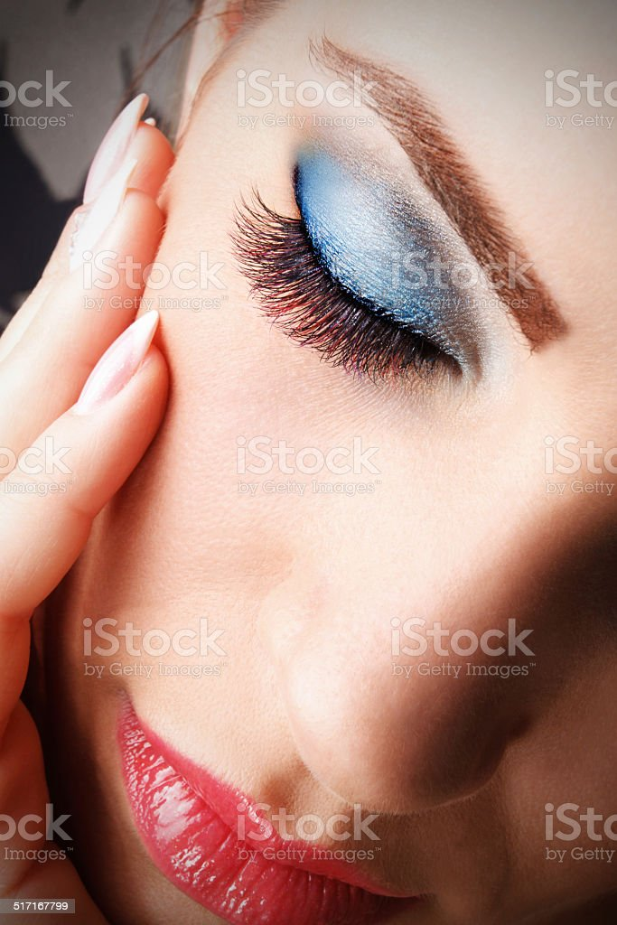 Beautiful young woman with make up stock photo