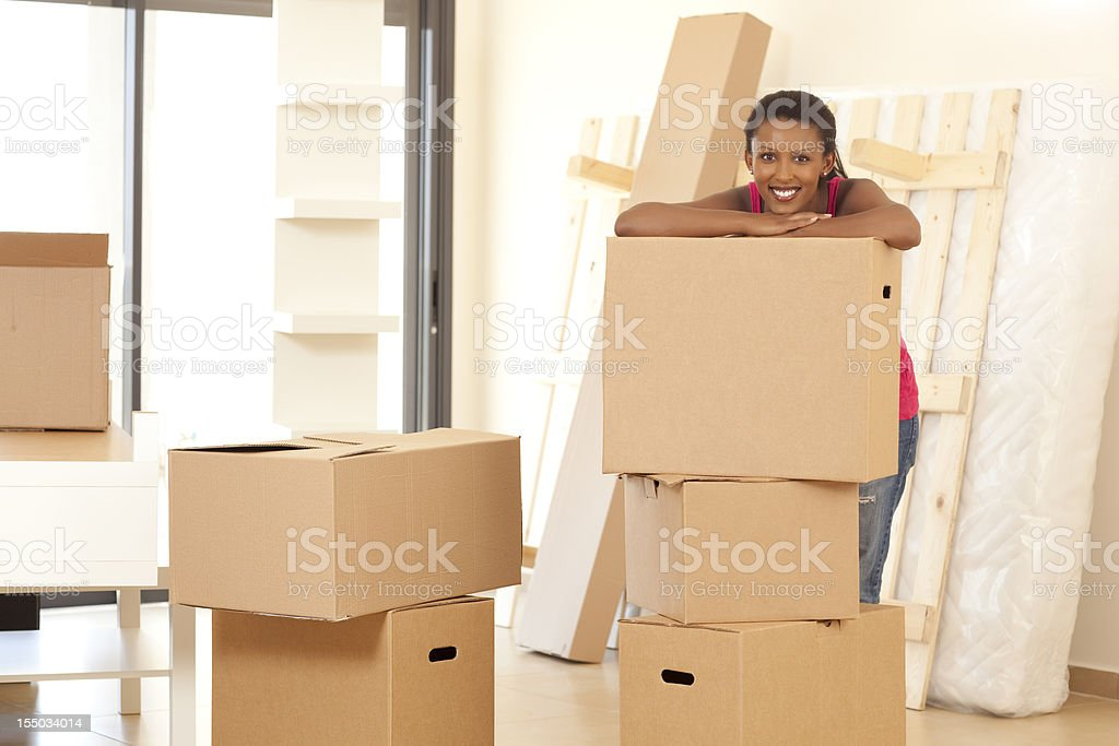 Beautiful young woman  with moving boxes. royalty-free stock photo