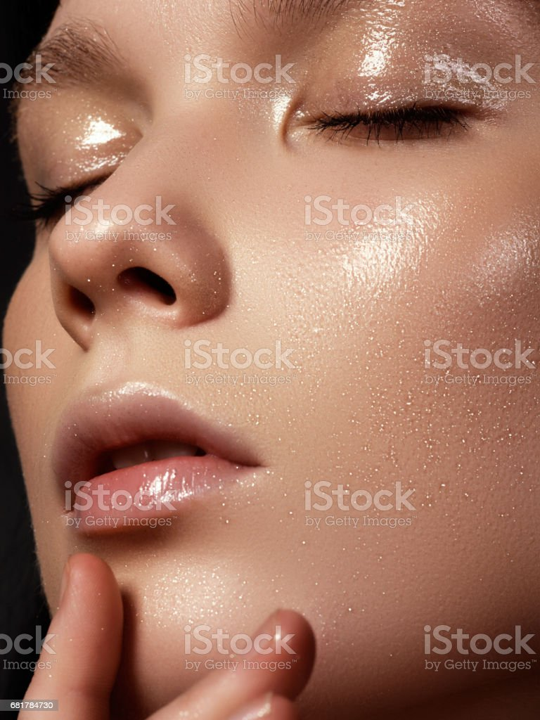 Beautiful young woman with perfect clean shiny skin, natural fas stock photo