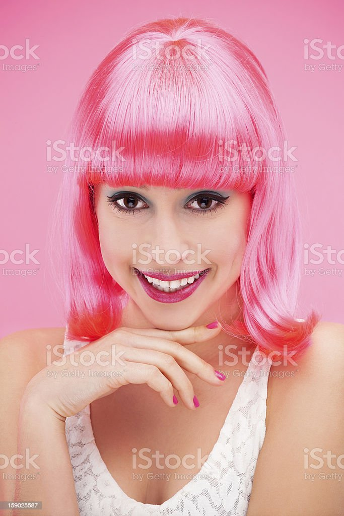 Beautiful young woman with pink hair royalty-free stock photo