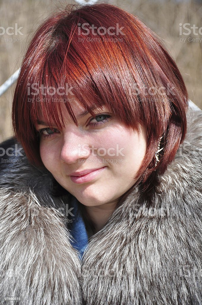 beautiful young woman with red hair royalty-free stock photo