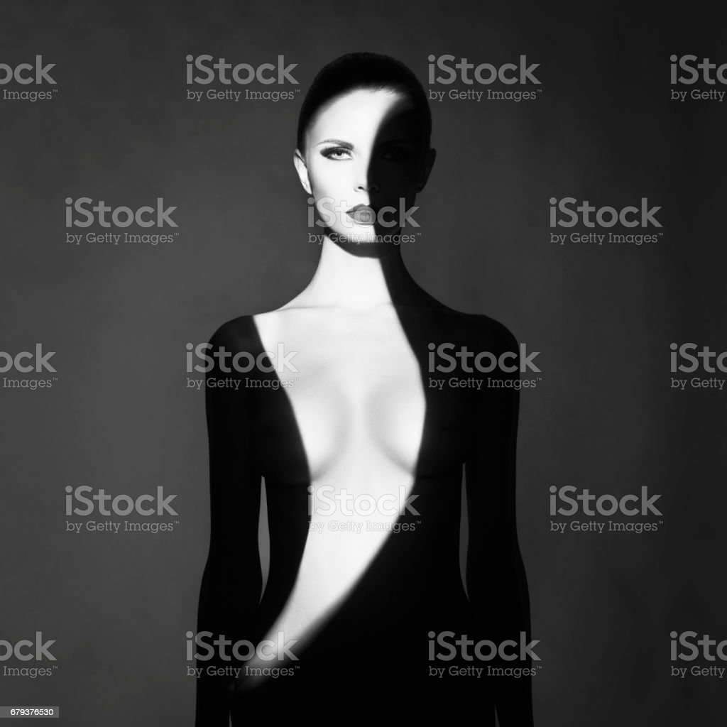 beautiful young woman with shadow dress on her body stock photo