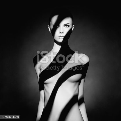 istock beautiful young woman with shadow dress on her body 679376678