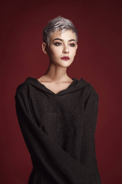Beautiful young woman with short grey hair stock photo