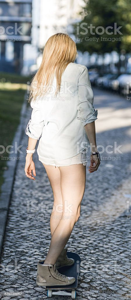 beautiful young woman with skateboard royalty-free stock photo