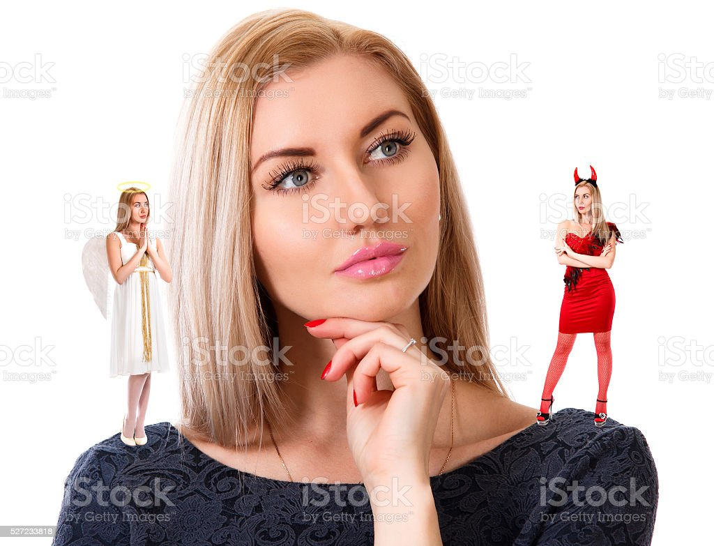 Beautiful young woman with small angel and demon stock photo