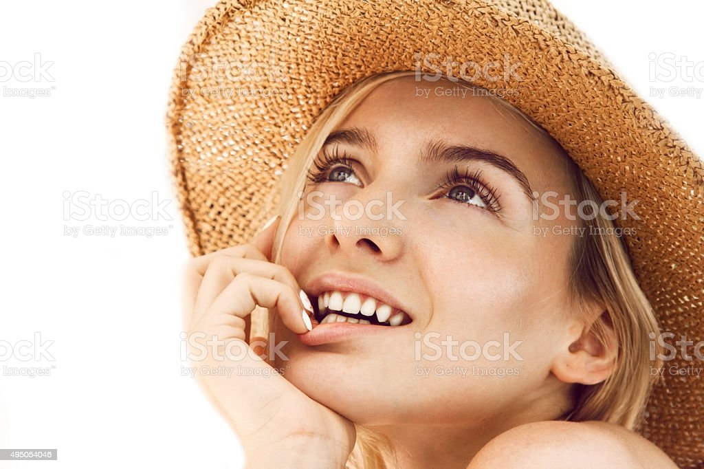 Beautiful young woman with straw hat stock photo