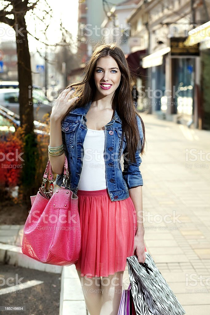 Beautiful young woman with the shopping bags royalty-free stock photo