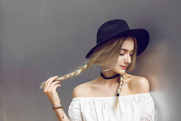 beautiful young woman with two pigtails - pigtails stock photos and pictures