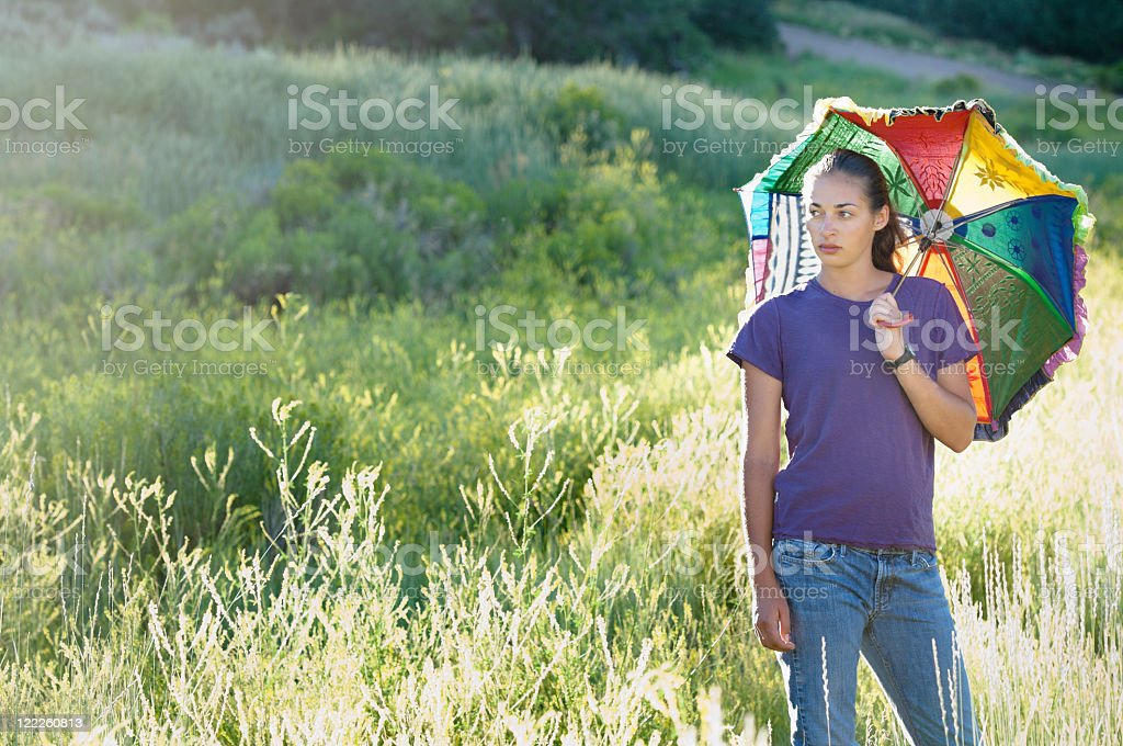 Beautiful young woman with umbrella stock photo