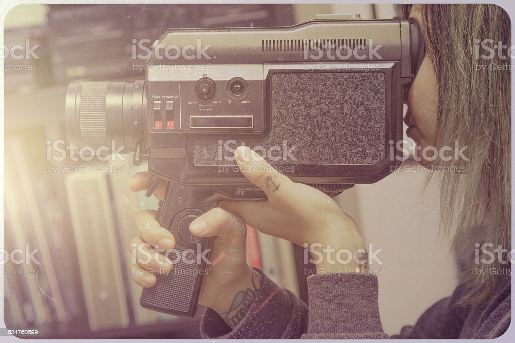 Beautiful young woman with video camera stock photo