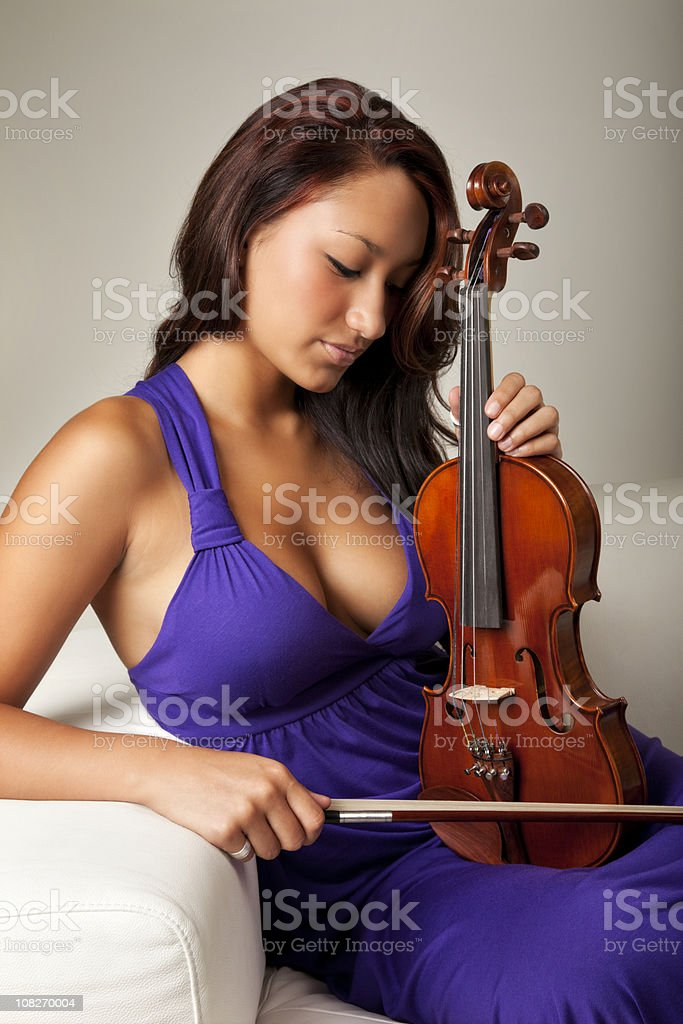 Beautiful Young Woman with Violin royalty-free stock photo