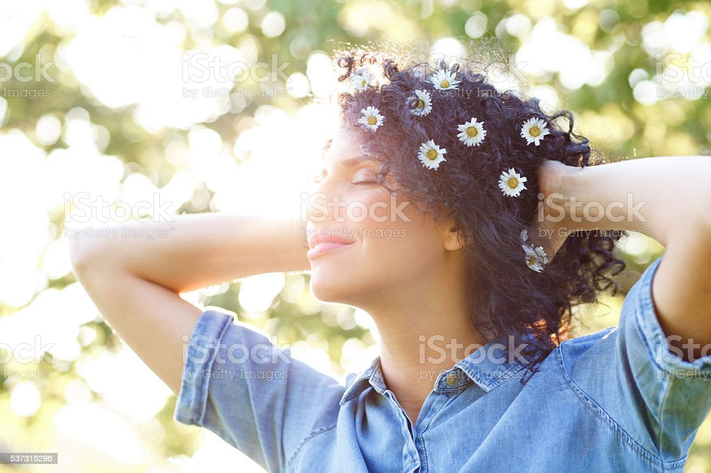 Beautiful young woman with white flowers in her hair stock photo beautiful young woman with white flowers in her hair royalty free stock photo mightylinksfo