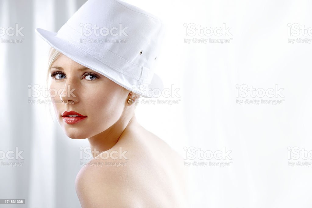 Beautiful young woman with white hat royalty-free stock photo