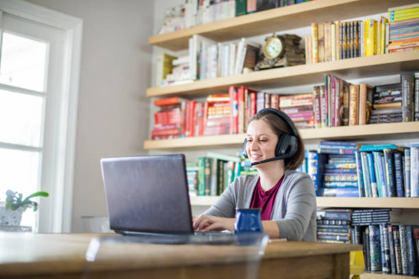 Beautiful young woman working from home stock photo