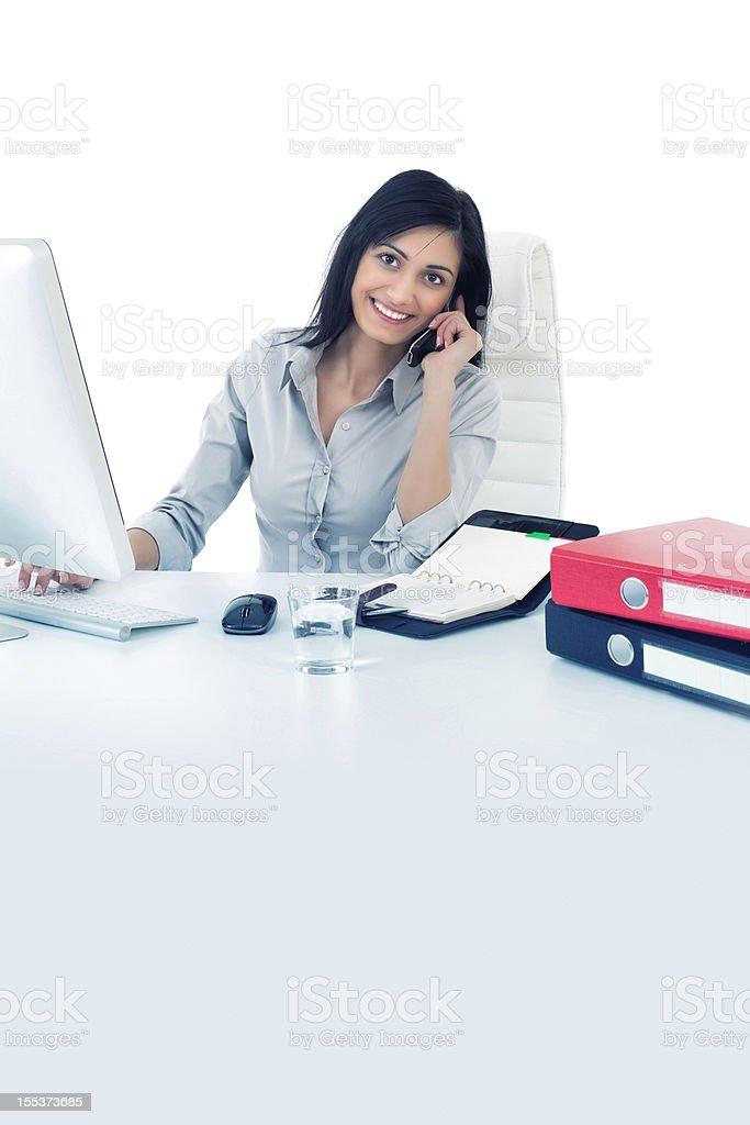 Beautiful young woman working in office royalty-free stock photo