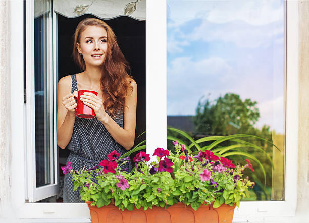Beautiful young womanenjoing morning with cup of coffee on a balcony , Kohtla Yarve, Estonia early 20th century stock pictures, royalty-free photos & images
