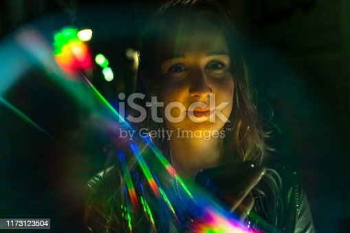Beautiful young woman's portrait with rainbow light reflections