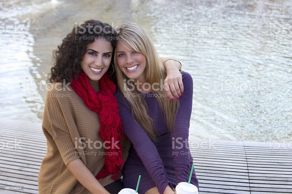 Beautiful young women as friends in a park royalty-free stock photo