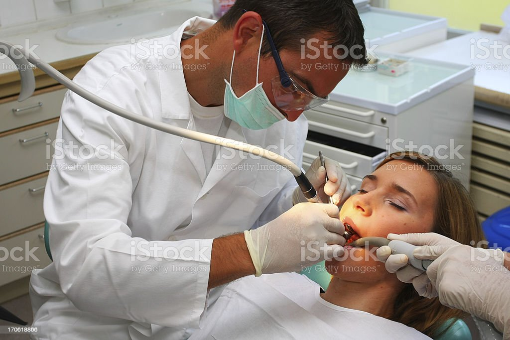 Beautiful young women at the dentist royalty-free stock photo