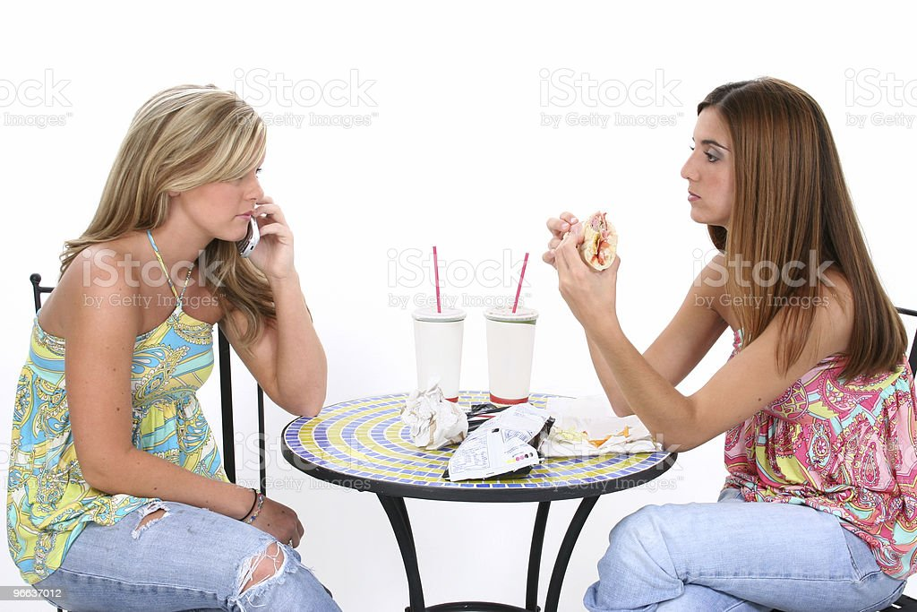 Beautiful Young Women Having Lunch Together royalty-free stock photo