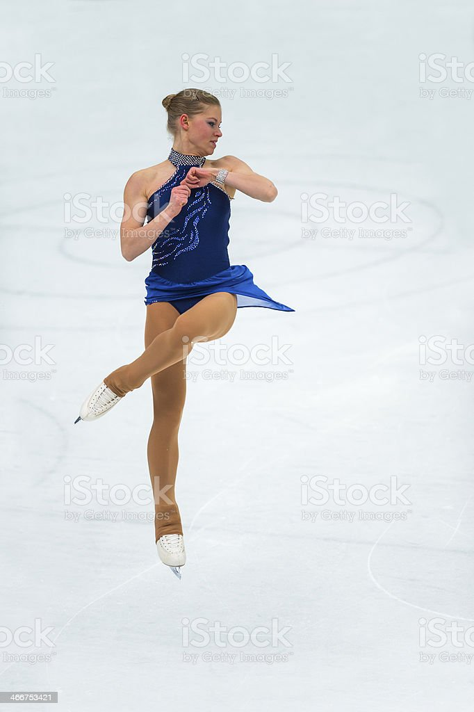 Beautiful Young Women Jumping During Figure Skating Competition stock photo